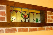 Beautiful stained glass panel in the Breakfast Room